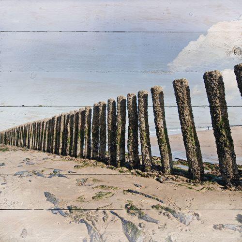 holzbild-poles-at-the-beach